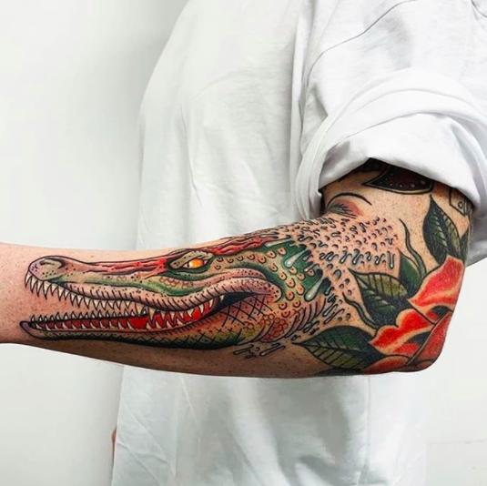 aligator forearm tattoo color