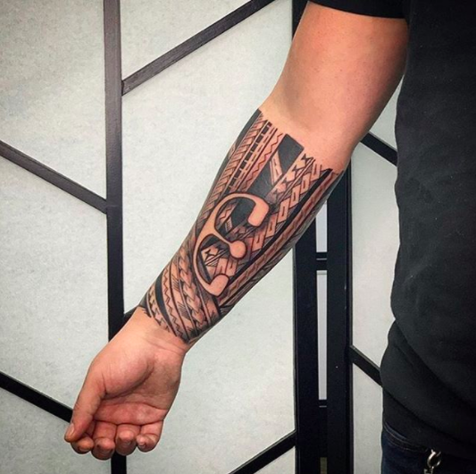 tribal forearm tattoo men