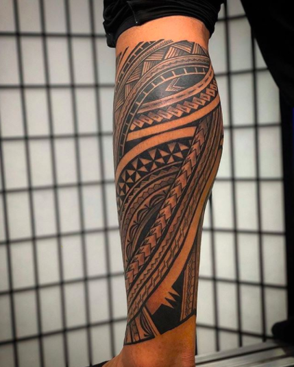 calf sleeve polynesian tattoo