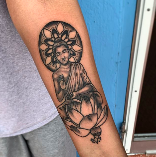 buddha inner forearm tattoo