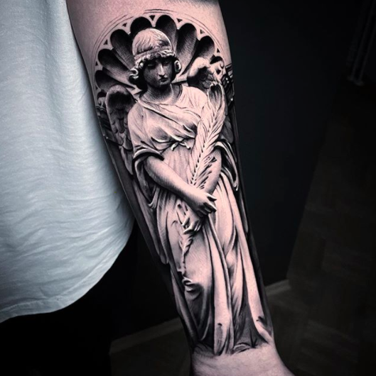 gothic forearm tattoo for men