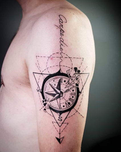 geometric shoulder tattoo with a compass