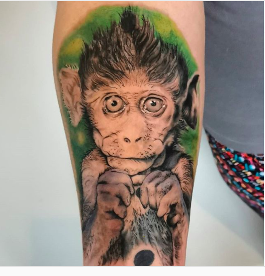 monkey tattoo forearm