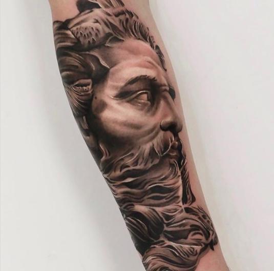 zeus forearm realistic tattoo