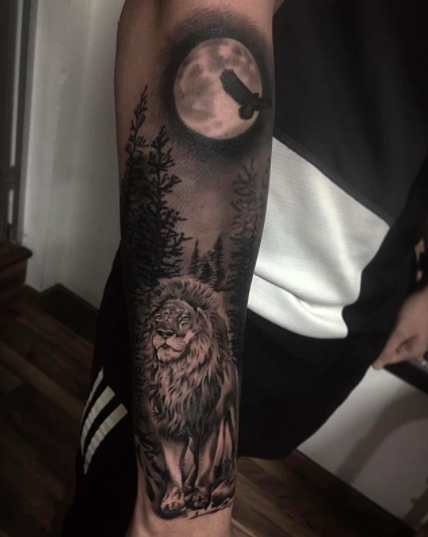 lion moon nightsky half sleeve tattoo