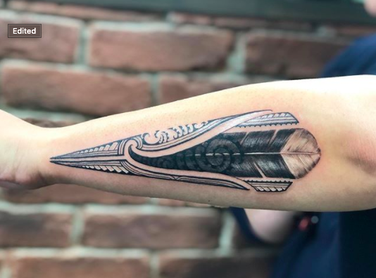 tribal spear tattoo forearm men