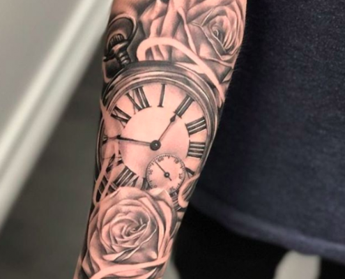 clock and roses forearm tattoo