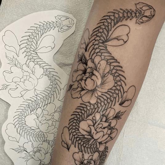 flower snake skeleton tattoo