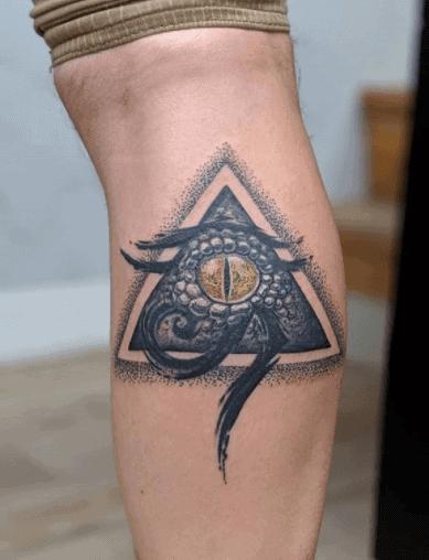 egyptian triangle eye of horus snake tattoo
