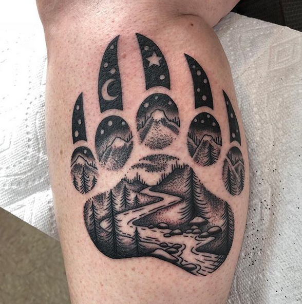 Bear Paw With Nature inside it chest tattoo by @darcynutt