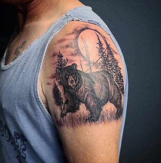 Black bear with forrest shoulder tattoo by @john_snow_art