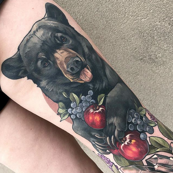Fun black bear eating apples by @tattoosandtealeaves