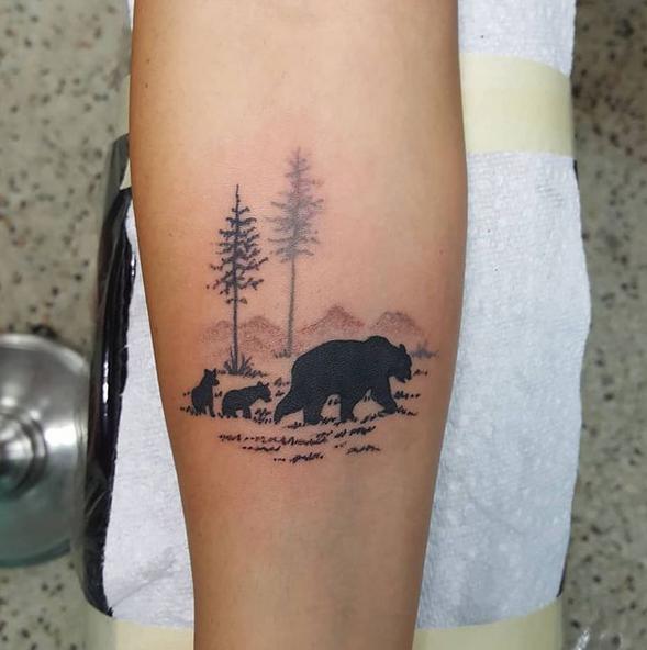 Mama bear in forrest tattoo by @richardlnagy