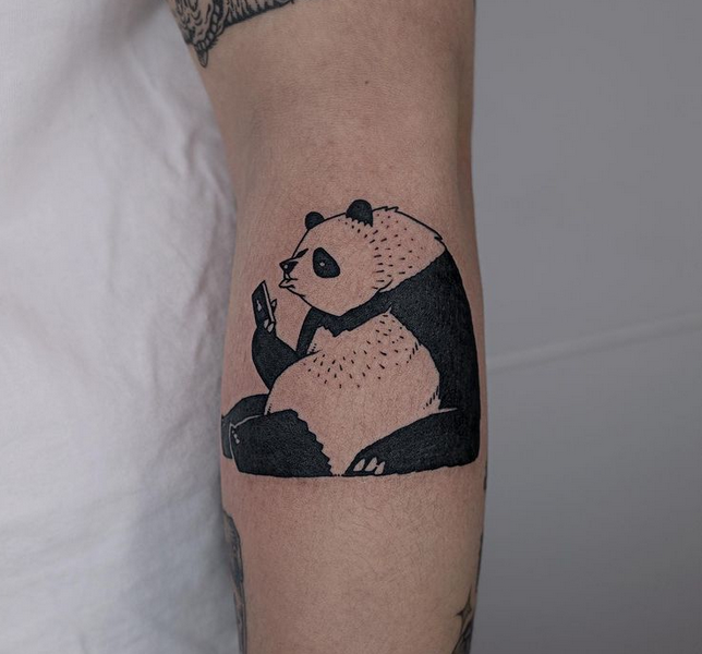 Panda reading a book tattoo by @black_fink