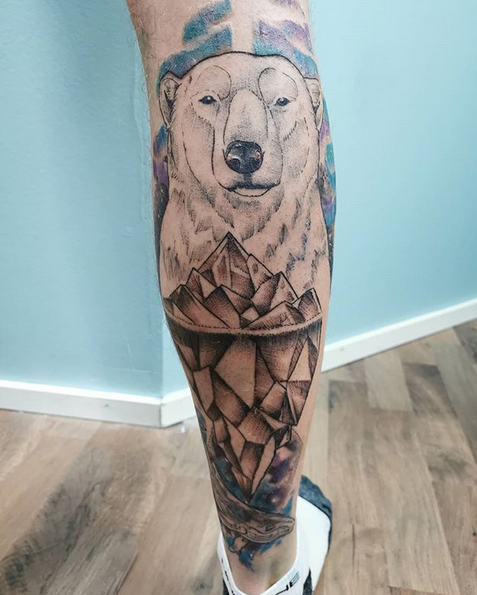 Polar bear with watercolor and geometry by @kipuisa_tattoo