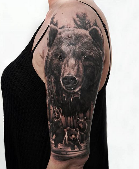 Realistic upperarm mother bear with cubs by @myszata_tattoo
