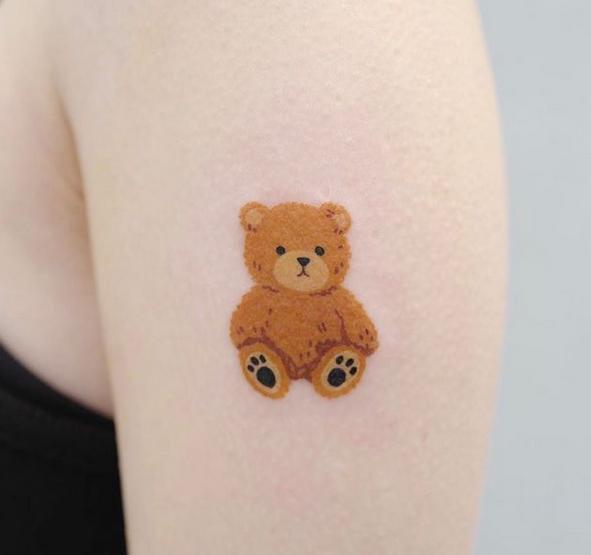 Tiny colorful teddy bear tattoo by @chocho_tattoo