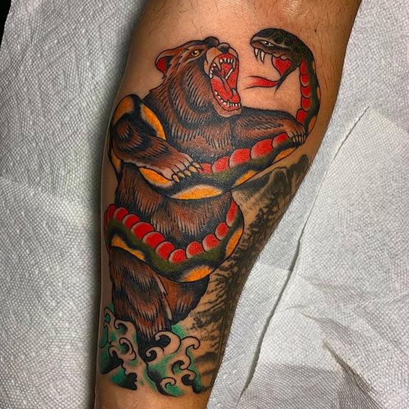 Traditional bear wrapped in a snake by @iandwcampbell