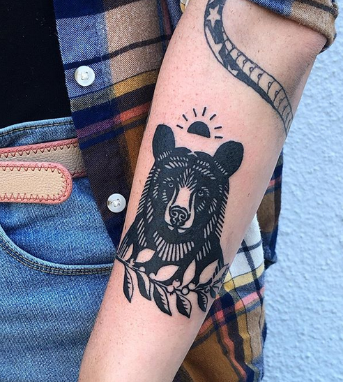 Traditional black bear tattoo with leaves by @lightning__bug_