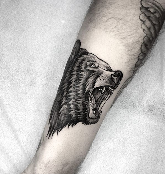 roaring black bear forearm tattoo
