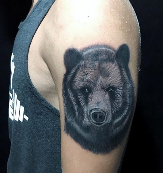 black bear head tattoo on shoulder