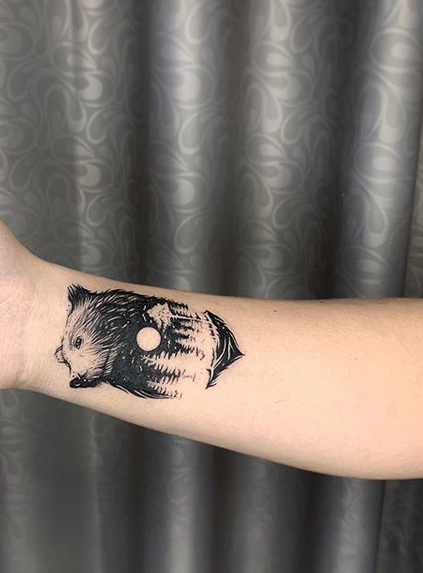 small bear with forrest tattoo