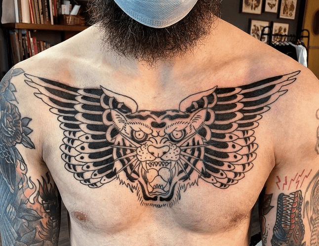 Black traditional chest tiger tattoo by @handanddagger