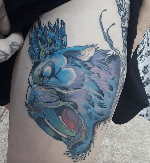 Blue saber tooth tattoo by @westtattoos187