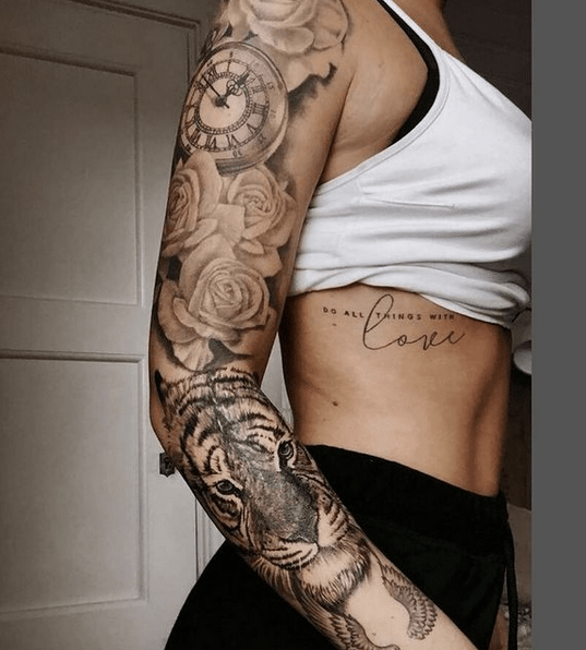 Clock roses and tiger female tattoo sleeve by @tattooparlourtoyou