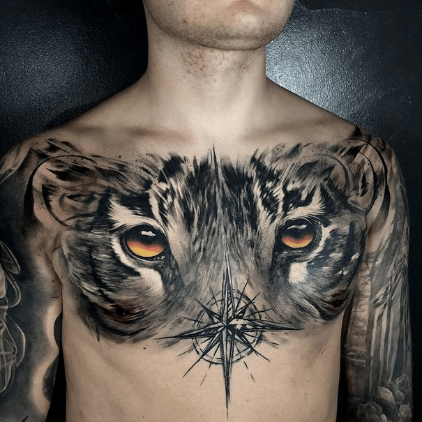 Full chest tiger eyes tattoo by @salvationtattoostudio