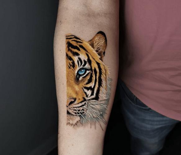 Half tiger face tattoo by @johnatan.moya.hernandez