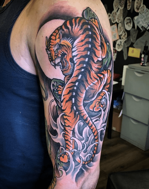 Japanese tiger tattoo with waves by @izzytattoocurran