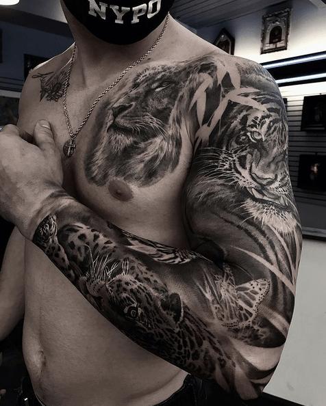 Lion tiger jaguar tattoo sleeve by @popotattoo