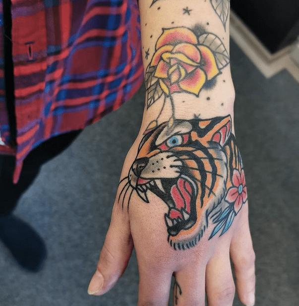 Neotrad tiger hand tattoo by @studiorosetattoo