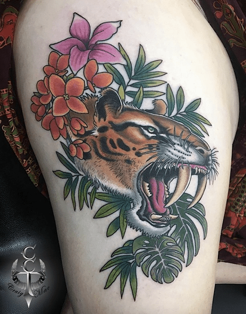 Neotraditional saber tooth tattoo by @cairnscitytattoo