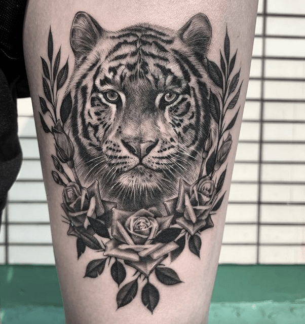 Realistic tiger and flowers by @rosie_tattooer