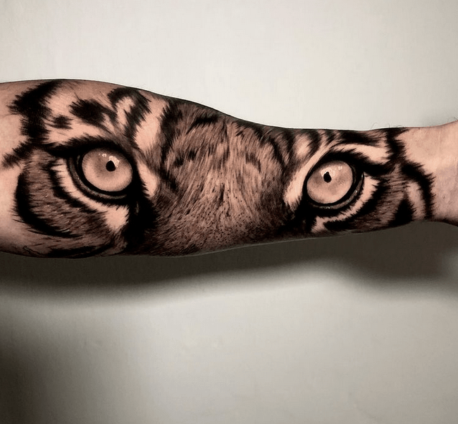 Realistic tiger eyes tattoo by @domjoeltattoo