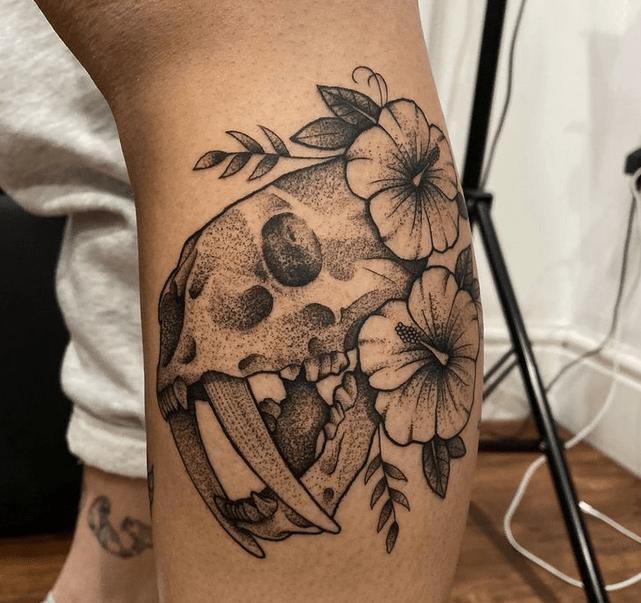 Saber tooth skull dotwork tattoo by @blackantlerstattoo