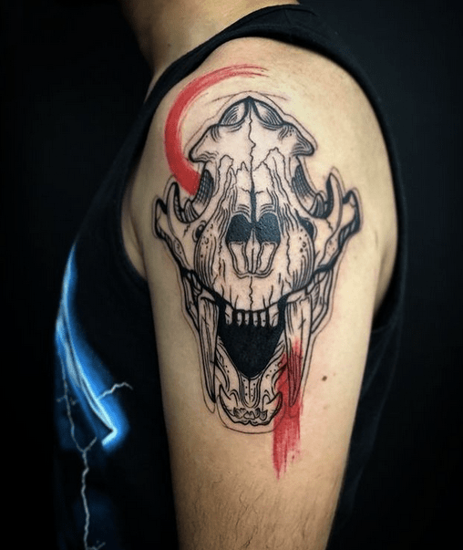 Saber tooth skull tattoo by @nymytattoo