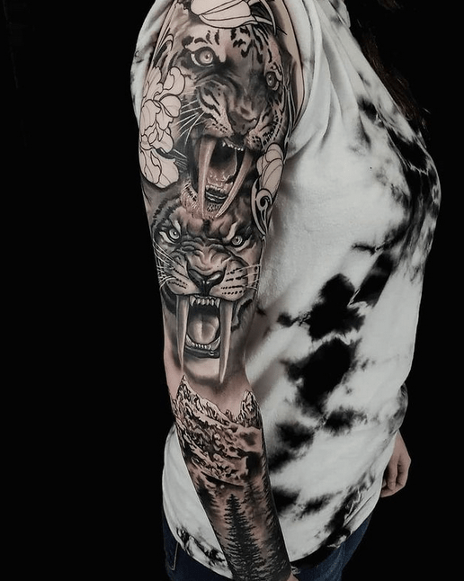 Saber tooth tiger sleeve tattoo by @inktherapytattoosolution