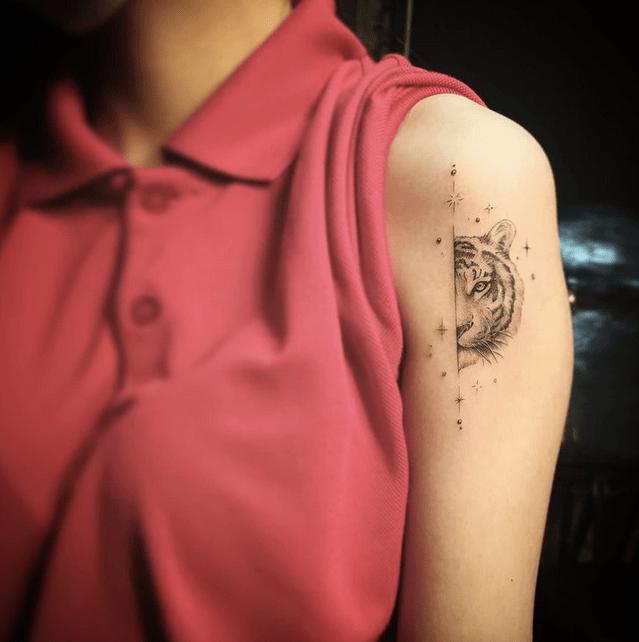 Small half of a tiger tattoo by @enigmcd