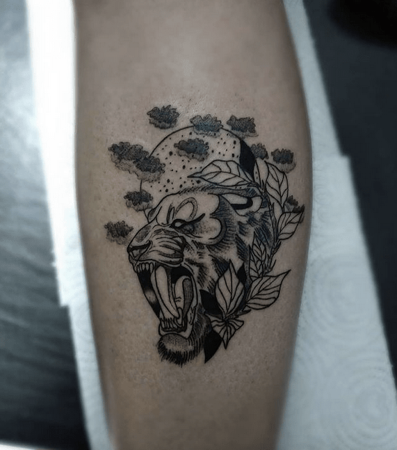 Small saber tooth with natural elements tattoo by @eduardoestevam__