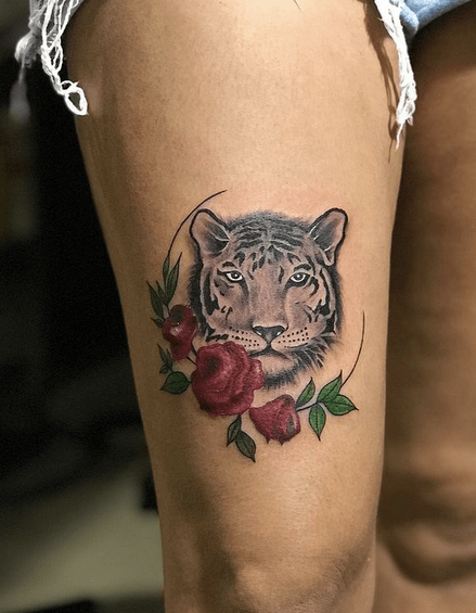 Small tiger with roses tattoo by @rakkaart