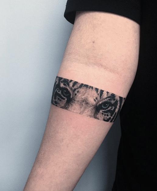 Tattoo band with tiger eyes by @raindog_hontattoo