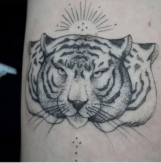 Three tiger heads tattoo by @crisalmeidatattoo