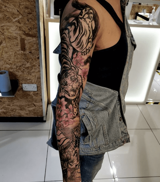 Tiger and coil fish sleeve tattoo by @anjaassasin11