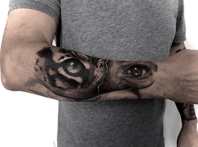 Tiger and human eye tattoo by @alice.peri94