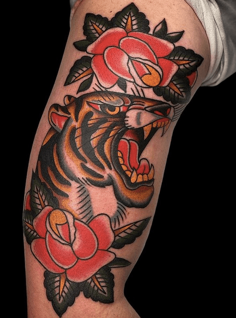 Tiger and roses traditional tattoo by @northernglorytattoo