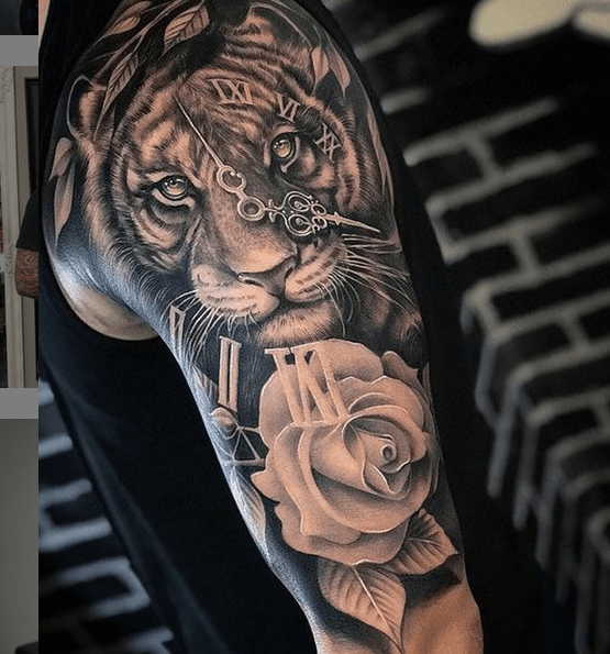 Tiger clock rose half sleeve tattoo by @tattooparlourtoyou