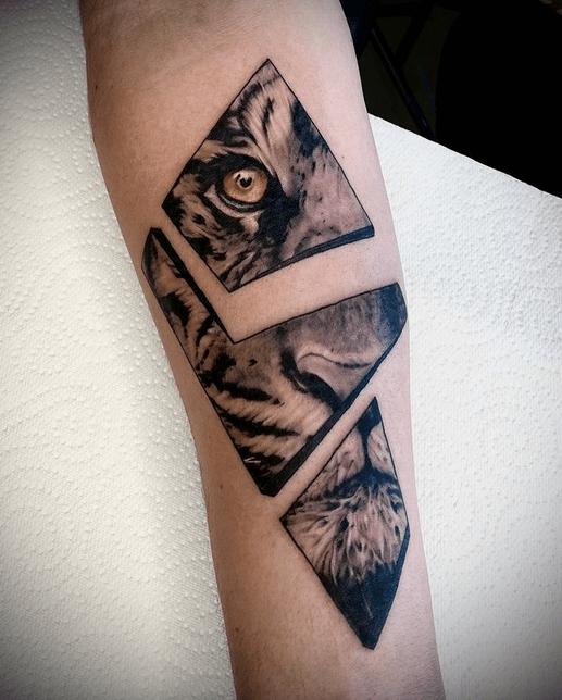 Tiger eye on broken glass tattoo by @davestavrostattoos
